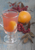Drink from mountain ash with oranges. Royalty Free Stock Photography
