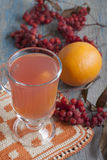 Drink from mountain ash with oranges. Royalty Free Stock Photo