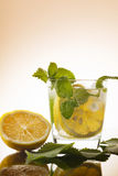 Drink non-alcoholic from lemon with mint leaves with ice. With reflection Royalty Free Stock Image