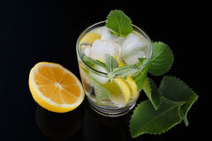 Drink non-alcoholic from lemon with mint leaves with ice. With reflection Stock Photo