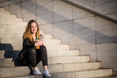 Drink on phone Royalty Free Stock Images