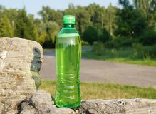Drink in a plastic bottle on a hot day Royalty Free Stock Photo