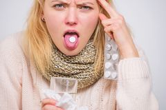 Drink plenty of fluids. Breaking fever concept. Girl take medicine to break fever. Headache and fever remedies. Woman stock image