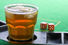 Drink on poker table Stock Photos