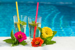 Drink by the pool. Fresh cold drink on the pool Stock Photography