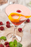 Drink with raspberries and passion fruit Royalty Free Stock Images