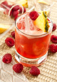 Drink with raspberry, pineapple and peach Stock Image