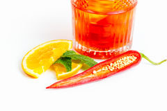 Drink with red pepper and orange Stock Image