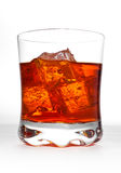 Drink on the rocks. A drink served over ice or on the rocks Stock Images