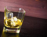 Drink series, glass of whiskey on old wood table Royalty Free Stock Image