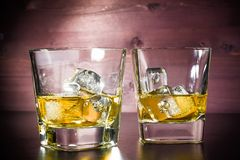 Drink series, glasses of whiskey on old wood table Royalty Free Stock Photo