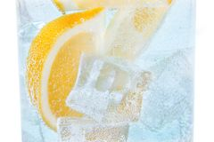 Drink with slices of lemon and ice. Soda cocktail tonic stock photo