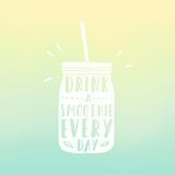 Drink a smoothie everyday. Mason jar with hand Stock Photo