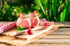 Drink smoothies summer strawberry on wooden table. Royalty Free Stock Image