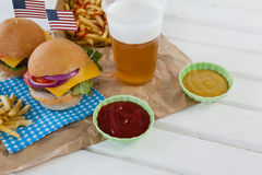 Drink and snacks decorated with 4th july theme. On wooden table Royalty Free Stock Photos