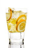 Drink with soda and lemons. Glass with fizzy liquid and lemon slice Royalty Free Stock Photography