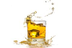 Drink. Splash icecube alcohol ice brandy whisky royalty free stock images