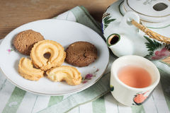 Drink tea with cookies. Royalty Free Stock Images