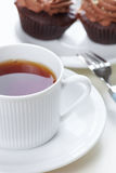 Drink tea with cupcakes Stock Images