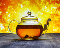 Teapot of fresh tea on sky background Stock Photos