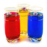 Drink three colors and flowers, the triad of red, yellow and blu. E, white background Royalty Free Stock Images