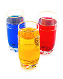 Drink three colors, the triad of red, yellow and blue. White background Royalty Free Stock Photography