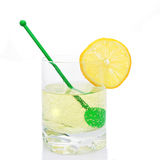 Drink in tumbler. Fizzy drink in tumbler with stirrer and lemon Royalty Free Stock Photos