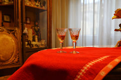 Drink for two. Pair glasses on red table Royalty Free Stock Photo