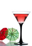 A drink and two cocktail umbrellas Stock Image