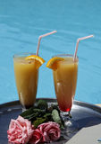 Drink for two near the pool Royalty Free Stock Photo