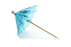 Drink umbrellas. Blue cocktail umbrella isolated on white background Stock Photos