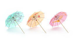 Drink umbrellas. Colorful cocktail umbrellas isolated on white background Stock Images