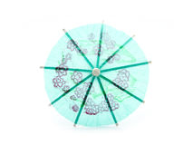Drink umbrellas. Green cocktail umbrella isolated on white background Royalty Free Stock Photo