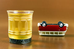 Drink and upended car Royalty Free Stock Images