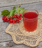 Drink of the viburnum on a wooden background Stock Image