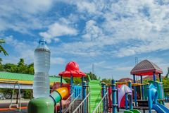 Drink water and bright blue sky In the playground. stock image
