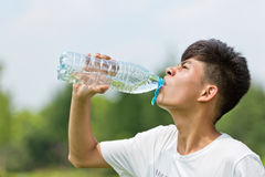 Drink water Chinese boy Stock Image