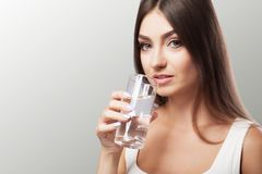 Drink water from the glass. Healthy Lifestyle. Portrait of a hap. Py young woman with a glass of fresh water. Health. Drinks Beauty. The concept of diet. Healthy stock photos