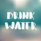 Drink water Het met de hand geschreven van letters voorzien, moderne inktkalligrafie stock illustratie