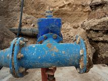 Drink water pipes joined gate valves and reduction members. Finished repaired. Old big drink water pipes joined with new blue gate valves and reduction joint Royalty Free Stock Images