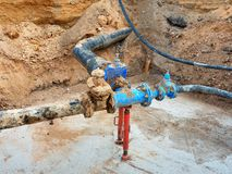 Drink water pipes joined gate valves and reduction members. Finished repaired Stock Images