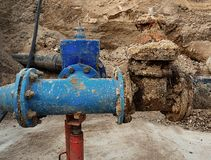 Drink water pipes joined gate valves and reduction members. Finished repaired. Old big drink water pipes joined with new blue gate valves and reduction joint Royalty Free Stock Image