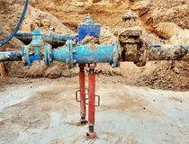 Drink water pipes joined gate valves and reduction members. Finished repaired. Old big drink water pipes joined with new blue gate valves and reduction joint Stock Images