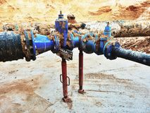 Drink water pipes joined gate valves and reduction members. Finished repaired. Old big drink water pipes joined with new blue gate valves and reduction joint Stock Photo