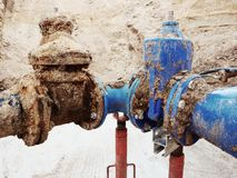 Drink water pipes joined gate valves and reduction members. Finished repaired. Old big drink water pipes joined with new blue gate valves and reduction joint Stock Image