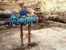 Drink water pipes joined gate valves and reduction members. Finished repaired. Old big drink water pipes joined with new blue gate valves and reduction joint Royalty Free Stock Photo