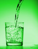 Drink Water poring into a glass stock photo