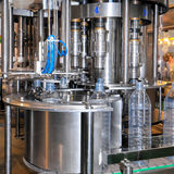 Drink water production line in industry Stock Photography