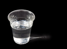Drink of water, sidelit, over black background Stock Photo