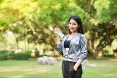 Drink water after sport. Beautiful young woman drink water after sport - outdoors training girl morning fitness exercises Royalty Free Stock Photography